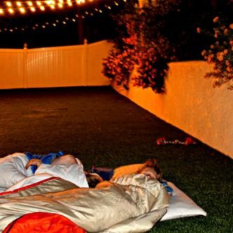 backyard, sleeping bags, camping, kids, children, boys, whit honea, fake grass, bug bites